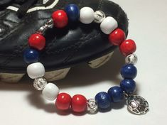 Wear the pride in your favorite soccer player on your wrist with a customized Player Pride Bracelet!  Each beautiful, customized bracelet has your player's number surrounded by beads in your team's colors and soccer charm!