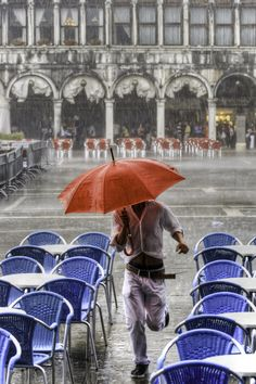 Escaping the rain in Piazza San Marco, Venice, Italy