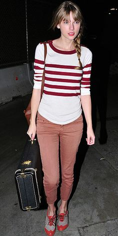 TAYLOR SWIFT  Rather than go the matchy-matchy route at LAX, the singer pairs terra-cotta skinnies and coral wingtip shoes, which harmonize well with her white-and-red striped shirt.