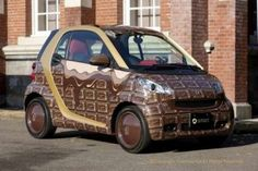 Smart car wrapped in chocolate. Yum and yum.