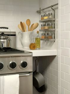 Spice Solution - Take advantage of unused wall space and install a wall-mounted spice rack to house jars of spices.