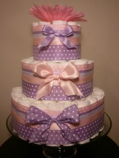 pink, purple, and yellow diaper cake | Pink and lavender, pink and purple