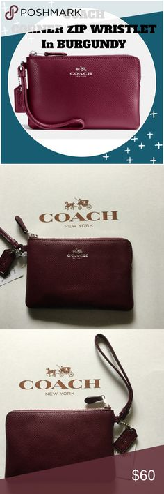 """COACH CORNER ZIP WRISTLET IN CROSSGRAIN LEATHER COACH CORNER ZIP WRISTLET IN CROSSGRAIN LEATHER. NWT wristlet in a beautiful """"Burgundy""""color. This wristlet has a zip closure with fabric lining. Credit card pockets(2) and wrist strap attached. COACH LOGO is in silver for a nice contrast. This handcrafted accessory was designed to hold small electronics, including standard iPhone®️,Samsung Galaxy®️,Blackberry®️, and other mobile devices. Please measure your phone before purchasing. Coach care…"""