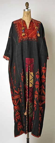 Palestinian embroidered linen tunic, silk appliqués, 1800-1941