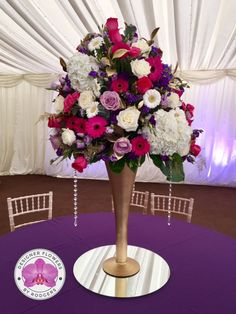 Table Centre Pieces   Designed On Tall Gold Trumpet Vases Sat On Mirrors.  White Avalanche Roses, Deep Purple And Lilac Lisianthus, White And Purpleu2026