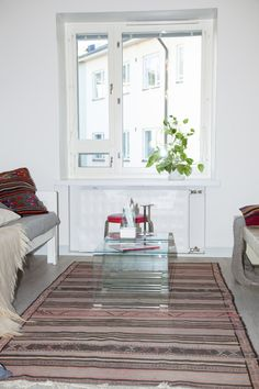 Interior design for living room - glass table - vintage sofa - Kilim carpet and cushions - Design by See and Feel Spatial Design, Helsinki, Finland
