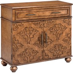Featuring bun feet and recessed damask-inspired accents, this ornate chest makes a bold statement in your dining room or entryway.Pro...