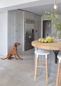 Kitchen Interior How the wall of cupboards may look with built in but stand alone fridge freezer, also nice wooden breakfast bar Bespoke Kitchens, Grey Kitchens, Home Kitchens, Kitchen Stools, Kitchen Flooring, Kitchen Decor, Kitchen Floor Tiles, Built In Kitchen Cupboards, Kitchen Ideas