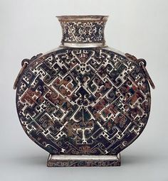 Freer Sackler Gallery – Ancient Chinese Pottery and Bronze.  This includes clay, jade and bronze that dominated materials used in the art of ancient China from around 4000 B.C.E. to the early centuries of C.E.  Vessel: Canteen
