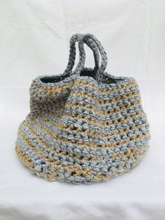 Discover thousands of images about Handmade crocheted hip handbag made from recycled strips of fabric and natural materials. Handmade Crocket bag with fabric strips. Crochet Doily Rug, Crochet Tote, Crochet Blocks, Crochet Handbags, Crochet Purses, Hand Crochet, Knit Crochet, Crotchet Bags, Knitted Bags