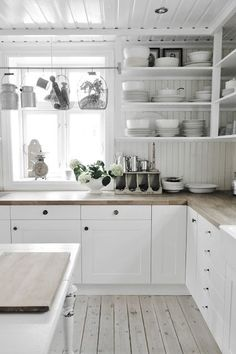 Love the beadboard and open shelf combination.