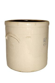 An antique stoneware crock will often be more treasured in the area where it was made. This crock is from an original family farm collection just south of Philadelphia. The presence of original handles contribute to its usefulness.  The original crock was used on the family farm and it can be examined for the following authentic antique characteristics:  - A shiny, glass-like surface with occasional bumps, which indicates that the crock was salt-glazed - A stenciled number 5 appears beneath…