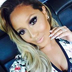 Makeover: Adrienne Bailon Makeup is more of an urban modern glam. Highlight too close to concealer and contour not blended. Precision, blending and placement. Side part isn't the best choice for her face shape she has a round face with rounded jaw middle part looks best. preference for best results highlights starting closer to the part for a glam look. xoxo Kriss
