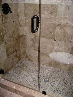 Using Tile in the Bathroom   bathroom   Pinterest   River rock floor     rock shower ideas   custom shower custom travertine shower with river rock  shower floor