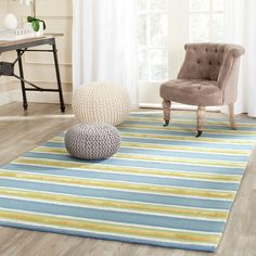 Summery hues of yellow and blue form Beach Stripe, a hand-hooked design from Isaac Mizrahi New York Collection Rugs that will brighten any room with a fun splash of color.