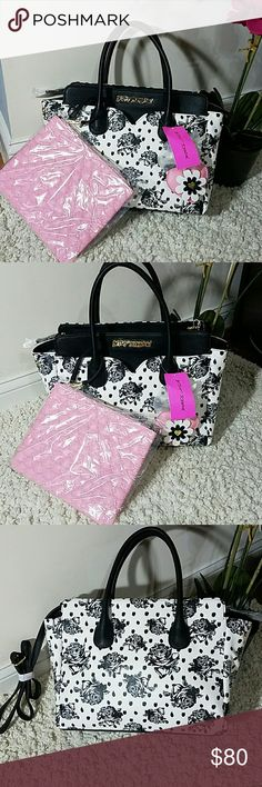 """Betsey Johnson """"Be Mine Dip"""" Satchel Combo Zip closure, Dual carrying handles 5"""" drop Removable Heart Key Chain, Back zip pocket Separate zippered pouch with wristlet strap in front pocket Fully Lined Interior with Back 1 wall zipper and 2 slip pockets Tote: 13"""" x 10"""" x 6"""" (WxHxD) Detachable adjustable strap 23"""" drop Exterior Features Front heart shaped slip pocket with zippered Wristlet pouch that ensures stylish flair, Zip top satchel ,Double Handles 5""""  Fully Lined printed Interior Betsey…"""