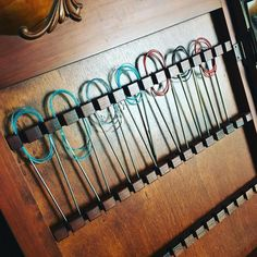 Antique jewellery cabinet converted into circular knitting needle storage, posted on IG by @thebluebrickish