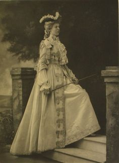 Lady Alexandra Acheson strikes a pose in a hunting costume of the Louis XV period ; the Duchess of Devonshire's Jubilee Costume Ball of 1897