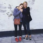 Creative Director Cecilia Blankens wearing The Karin, a moccasin in red suede.