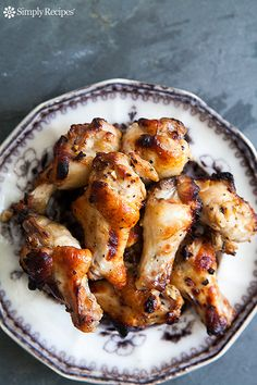 Perfect for game day! Chicken wing drummettes, marinated in honey, mustard, olive oil, garlic, and then roasted until done. On SimplyRecipes.com