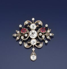 A 19th century diamond and ruby brooch/pendant The central millegrain-set old brilliant-cut diamond within an openwork old-cut diamond foliate surround, with two pear-shaped ruby accents, with an old brilliant and rose-cut diamond pear-shaped drop, to a tracelink neckchain, circa 1890
