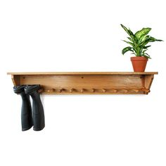 Oak wall hanging welly rack for six pairs of welly boots. Hand-made wooden wellington rack in English Oak with shelf above. Buy Oak wall mounted welly racks