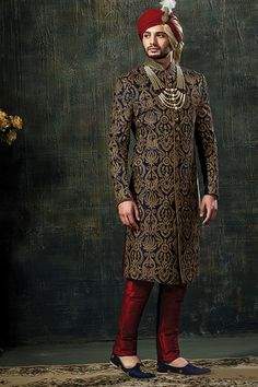 Add a vibrant burst of color to your wardrobe with this navy blue indian wedding sherwani. Men Wedding Attire Guest, Sherwani For Men Wedding, Wedding Dresses Men Indian, Groom Wedding Dress, Sherwani Groom, Mens Sherwani, Indian Wedding Couple, Indian Wedding Wear, Wedding Men