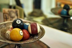 cool display for a game room - vintage pool table balls