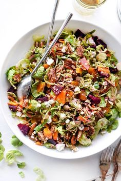 This easy shaved Brussels sprouts salad sweetened with roasted beets and crunchy pecans is delicious as a healthy vegetarian main dish or served as a side.