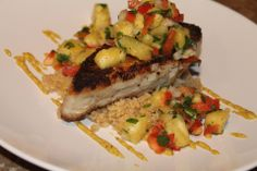 Shark with Mango Salsa in a bed of couscous  by Gabriela Dedolph