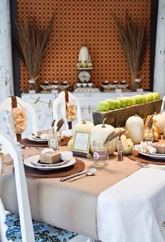 An inviting fall table with fresh green apples, a twig placeholder and mason jar glasses. #fall #Thanksgiving