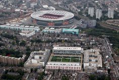 A View from the North Bank, Highbury to the Grove LONDON, ENGLAND – JULY An aerial view of The Emirates Stadium home of Arsenal Football Club with their former home Highbury in the foreground Arsenal Stadium, Arsenal Football, Arsenal Fc, Soccer Stadium, Football Stadiums, Arsenal Tattoo, London Football, Liverpool Anfield, Beautiful Yoga