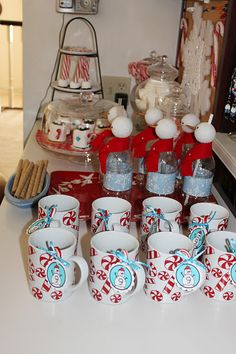 Hot chocolate bar: thinking of decorating dollar store mugs for guests to take home.