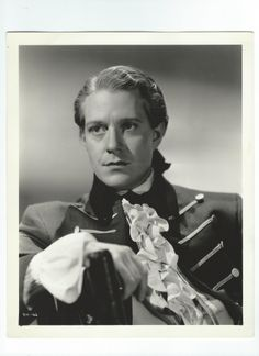 Double weight, original, vintage photo of the dashing Captain Richard Warrington (Nelson Eddy) by MGM photographer Virgil Apger - from Naughty Marietta (1935) - ESCANO COLLECTION