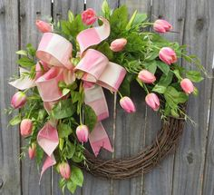 This spring wreath is characterized by the most life-like tulips we have ever seen! We actually stored these tulips in a bucket in our retail