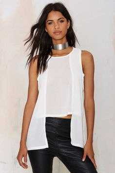 *Hard geometric lines contrast nicely with sheer, drape-y fabric. On My Level Cape Tank Top - White - Tops