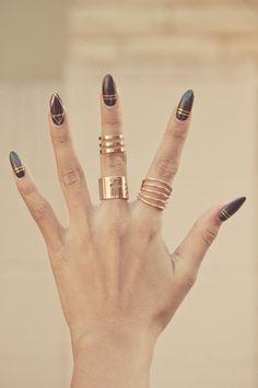Grey and gold nail art.