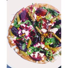 Roasted beets, jalepeño, feta, pickled asparagus, & arugula pizza on a wheat pita crust