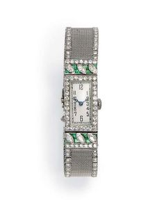 AN ART DECO EMERALD AND DIAMOND WRISTWATCH   With nickel-finished lever movement, 17 jewels, the cream-colored rectangular dial with black Arabic numerals and blued-steel hands, within a circular-cut diamond bezel, with marquise-cut diamond and calibré-cut emerald detail, to the mesh band, bordered by single-cut diamonds, mounted in platinum, circa 1925, 6¼ ins.  Movement signed Henry Sandoz, no. 66932 and 475 Cute Watches, Ladies Watches, Wrist Watches, Vintage Watches, Marquise Cut Diamond, Diamond Cuts, Emerald Diamond, Art Deco Jewelry, Fine Jewelry