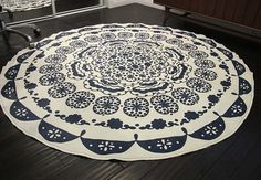 You won't believe how quickly a tablecloth converts into a DIY rug!