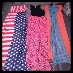3 maxi dresses Size medium, flag dress and black top dress never worn. Orange and blue dress only worn once. Dresses Maxi