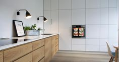 Since you do have a full pantry tucked behind the kitchen, we can play with doing no upper cabinets elsewhere. Wall-sconces are one way to add interest and uniqueness to a kitchen. Kitchen Redo, Living Room Kitchen, Kitchen Design, Upper Cabinets, Kitchen Cabinets, Nordic Living, Bespoke Kitchens, Cuisines Design, Kitchen Interior