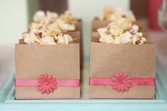 Make brown bags pretty for popcorn, chips, cookies and more! Choose a ribbon and flower in school colors.