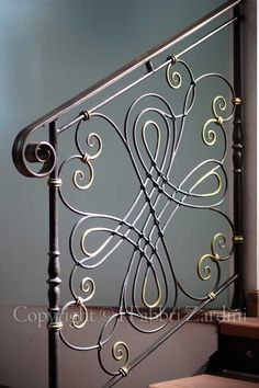 Love this wrought iron detail on the railing!  Visit stonecountyironworks.com for more beautiful wrought iron designs!