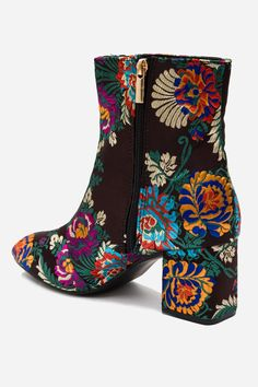 Ankle boots. Material: 100% Textile Upper Features All-over embroidery, side zip…