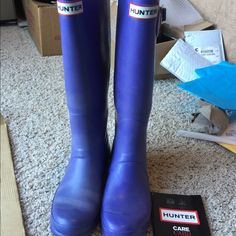 Hunter boots purple with hunter socks Hunter boots purple size 7. Worn about ten times in good condition. See pics for details. Comes with fleece socks worn once. Hunter Boots Shoes Winter & Rain Boots