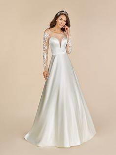 Moonlight Tango T887 is meant for a bride looking for a modern yet traditional bridal gown. This stunner includes long sleeves and sequin details that will make your heart burst with joy. The satin material offers a sleek style, giving you an old hollywood glam look.  #chicxmoonlighttango #longsleeveweddingdress #modernbride #satinweddingdress