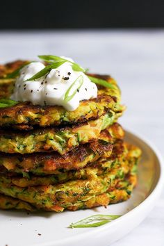 These crispy zucchini fritters are easy to make, low calorie and perfect for going alongside of grilled steak or chicken.