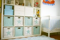 Pinty Plus pale turquoise and broken white used to makeover wicker Ikea baskets in a Kallax unit with star stencils
