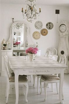 A wooden grandfather clock is the ultimate rustic chic must-have when painted white.